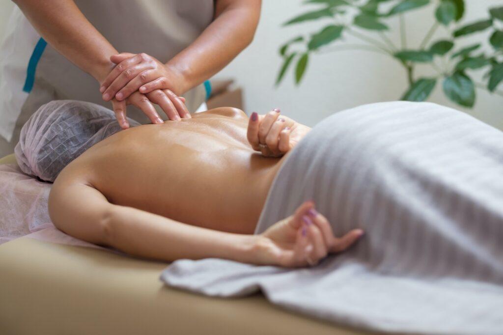 Caucasian woman getting a spine massage in the spa salon